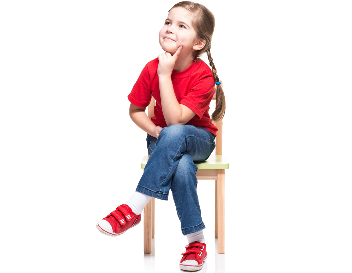 girl sitting cross legged on chair